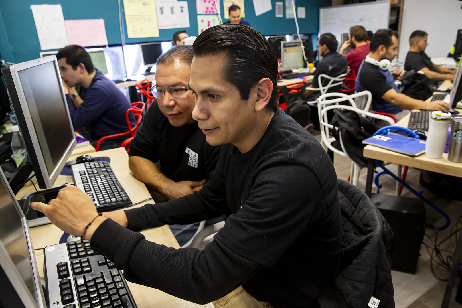 Orlando Mendoza works during classes of Hola Code, a nonprofit that offers a software training for returnees and refugees in Mexico. Mendoza recently graduated from the program and secured a job.