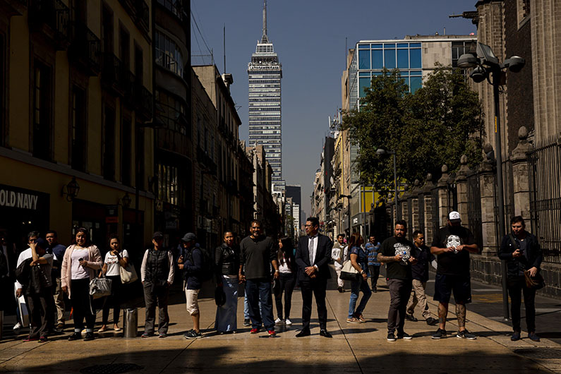 Pedestrians walk through Mexico City. About 21 million people live in the greater metropolitan area. (Erika Schultz / The Seattle Times)