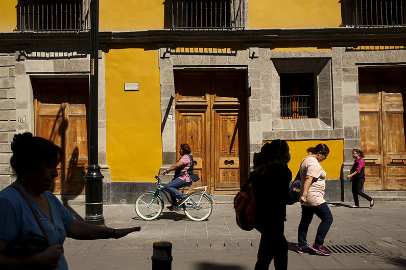 Pedestrians cycle and bike near Mexico City's Zocalo.