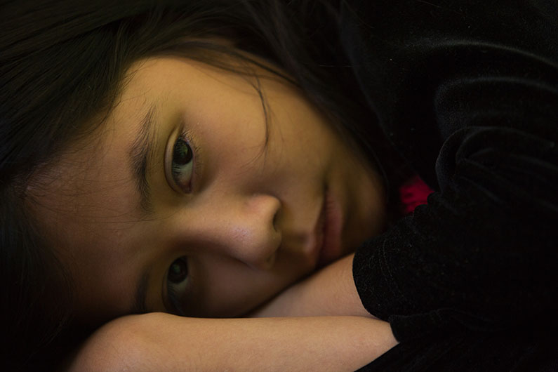 Paulina Zarazua, 10, rests inside her Mexico City apartment.